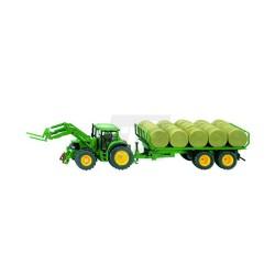 John Deere tractor con remolque y fardos